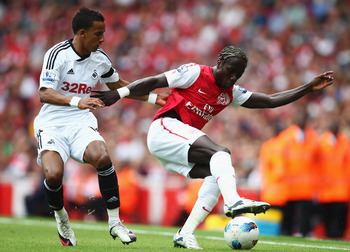 LONDON, ENGLAND - SEPTEMBER 10:  Bacary Sagna of Arsenal holds off Scott Sinclair of Swansea City during the Barclays Premier League match between Arsenal and Swansea City at Emirates Stadium on September 10, 2011 in London, England.  (Photo by Clive Maso