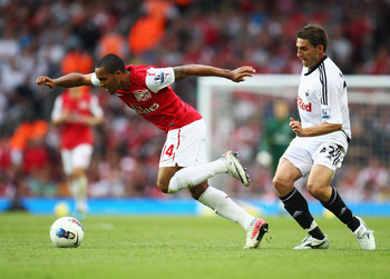 LONDON, ENGLAND - SEPTEMBER 10:  Theo Walcott of Arsenal evades Angel Rangel of Swansea City during the Barclays Premier League match between Arsenal and Swansea City at Emirates Stadium on September 10, 2011 in London, England.  (Photo by Clive Mason/Get