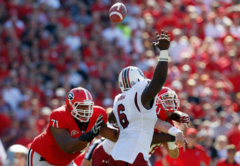 ATHENS, GA - SEPTEMBER 10:  Aaron Murray #11 of the Georgia Bulldogs is hit by Melvin Ingram #6 and another defender of the South Carolina Gamecocks at Sanford Stadium on September 10, 2011 in Athens, Georgia.  (Photo by Kevin C. Cox/Getty Images)