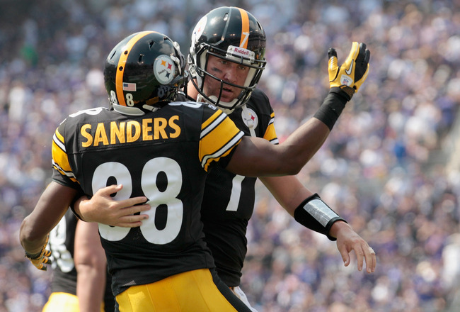 BALTIMORE, MD - SEPTEMBER 11: Quarterback  Ben Roethlisberger #7 (R) of the Pittsburgh Steelers celebrates throwing a touchdown pass to  Emmanuel Sanders #88 during first half of the season opener at M&T Bank Stadium on September 11, 2011 in Baltimore, Ma
