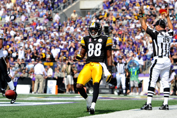BALTIMORE, MD - SEPTEMBER 11:  Emmanuel Sanders #88 of the Pittsburgh Steelers celebrates his team's only touchdown against the Baltimore Ravens at M&T Bank Stadium on September 11, 2011 in Baltimore, Maryland. The Ravens defeated the Steelers 35-7. (Phot