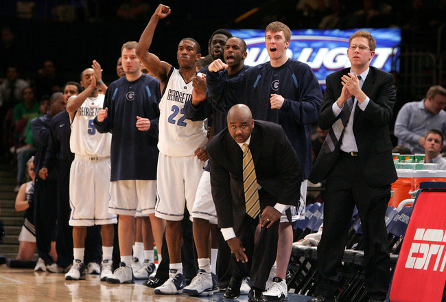 NEW YORK - MARCH 09:  Head coach John Thompson III of the Georgetown Hoyas and his bench watches during the final moments of a game against the Seton Hall Pirates during round one of the Big East Men's Basketball Championship on March 9, 2005 at Madison S