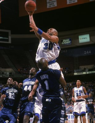 15 Jan 2001:  Darius Lane #30 of the Seton Hall Pirates shoots the ball against Demetrius Hunter #1 of the Georgetown Bulldogs during the game at the Continental Airlines Arena in South Orange, New Jersey. The Bulldogs defeated the Pirates 99-91. Mandator