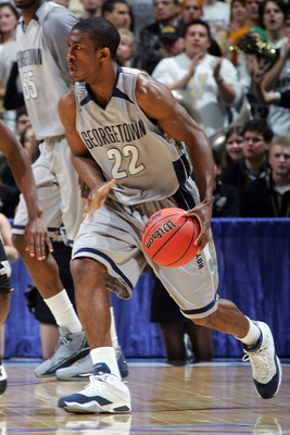 EAST RUTHERFORD, NJ - MARCH 23:  Tyler Crawford #22 of the Georgetown Hoyas handles the ball against the Vanderbilt Commodores during the NCAA Men's East Regional Semifinal at Continental Airlines Arena on March 23, 2007 in East Rutherford, New Jersey.  (