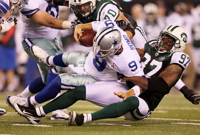 EAST RUTHERFORD, NJ - SEPTEMBER 11:  Calvin Pace #97 of the New York Jets sacks Tony Romo #9 of the Dallas Cowboys during their NFL Season Opening Game at MetLife Stadium on September 11, 2011 in East Rutherford, New Jersey. The Jets won 27-24. (Photo by