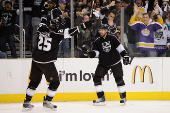 LOS ANGELES, CA - APRIL 25: Dustin Penner #25 and Justin Williams #14 of the Los Angeles Kings celebrate after a goal by Williams against the San Jose Sharks in the second period of game six of the Western Conference Quarterfinals during the 2011 NHL Stan