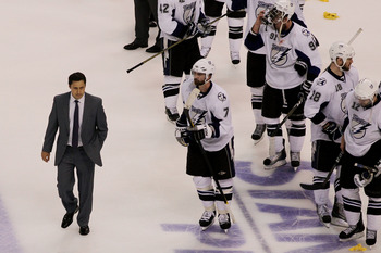 BOSTON, MA - MAY 27:  Head coach Guy Boucher of the Tampa Bay Lightning and his team react after their o to 1 loss to the Boston Bruins in Game Seven of the Eastern Conference Finals during the 2011 NHL Stanley Cup Playoffs at TD Garden on May 27, 2011 in