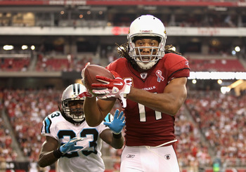 GLENDALE, AZ - SEPTEMBER 11:  Wide receiver Larry Fitzgerald #11 of the Arizona Cardinals makes a reception past safety Sherrod Martin #23 of the Carolina Panthers during the NFL season opening game at the University of Phoenix Stadium on September 11, 20