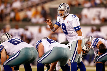 EAST RUTHERFORD, NJ - SEPTEMBER 11:  Quarterback Tony Romo #9 of the Dallas Cowboys calls out signals at the line of scrimmage against the New York Jets during their NFL Season Opening Game at MetLife Stadium on September 11, 2011 in East Rutherford, New