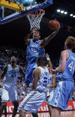 23 Dec 2000:  Julius Peppers #45 of the University of North Carolina Tar Heels leaps up to sink the ball during the game against the University of California in Los Angeles (UCLA) Bruins at the Pauley Pavilion in Los Angeles, California.  The Tar Heels de