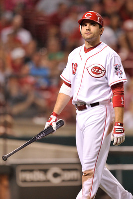 CINCINNATI, OH - AUGUST 26:  Joey Votto #19 of the Cincinnati Reds walks back to the dugout after striking out in the bottom of the eighth with runners on base against the Washington Nationals at Great American Ball Park on August 26, 2011 in Cincinnati,