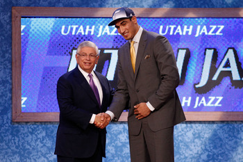 NEWARK, NJ - JUNE 23:  Enes Kanter (R) from Istanbul, Turkey greets NBA Commissioner David Stern after he was selected #3 overall by the Utah Jazz in the first round during the 2011 NBA Draft at the Prudential Center on June 23, 2011 in Newark, New Jersey