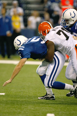 INDIANAPOLIS, IN - SEPTEMBER 18: Kerry Collins #5 of  the Indianapolis Colts is sacked by Alfyba Rubin #71 of the Cleveland Browns at Lucas Oil Stadium on September 18, 2011 in Indianapolis, Indiana. (Photo by Scott Boehm/Getty Images)