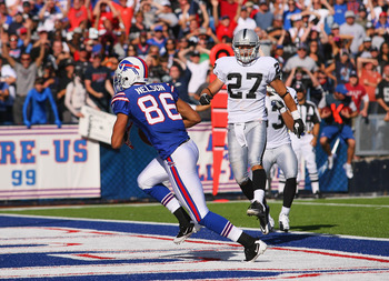 ORCHARD PARK, NY - SEPTEMBER 18: David Nelson #86 of the Buffalo Bills catches the game winninh touchdown ahead of  Matt Giordano #27 of the Oakland Raiders  at Ralph Wilson Stadium on September 18, 2011 in Orchard Park, New York.Buffalo won 38-35.  (Phot