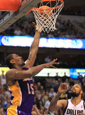 DALLAS, TX - MARCH 12:  Forward Ron Artest #15 of the Los Angeles Lakers takes a shot against Tyson Chandler #6 of the Dallas Mavericks at American Airlines Center on March 12, 2011 in Dallas, Texas.  NOTE TO USER: User expressly acknowledges and agrees t