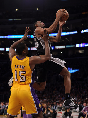 LOS ANGELES, CA - APRIL 12:  James Anderson #25 of the San Antonio Spurs goes in for a layup in front of Ron Artest #15 of the Los Angeles Lakers during a 102-93 Laker win at Staples Center on April 12, 2011 in Los Angeles, California.  NOTE TO USER: User