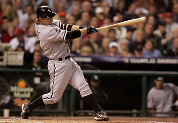 HOUSTON - OCTOBER 25:  Joe Crede #24 of the Chicago White Sox hits a solo home run against the Houston Astros in the fifth inning during Game Three of the 2005 Major League Baseball World Series at Minute Maid Park on October 25, 2005 in Houston, Texas.