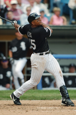 CHICAGO - AUGUST 6:  Carlos Lee #45 of the Chicago White Sox bats against the Kansas City Royals during the game on August 6, 2003 at U.S. Cellular Field in Chicago, Illinois.  The White Sox defeated the Royals 4-3.  (Photo by Jonathan Daniel/Getty Images