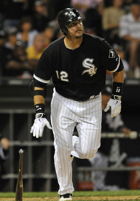 CHICAGO, IL - JULY 25: A.J. Pierzynski #12 of the Chicago White Sox hits a solo home-run in the sixth inning against the Detroit Tigers on July 25, 2011 at U.S. Cellular Field in Chicago, Illinois. The White Sox defeated the Tigers 6-3.  (Photo by David B