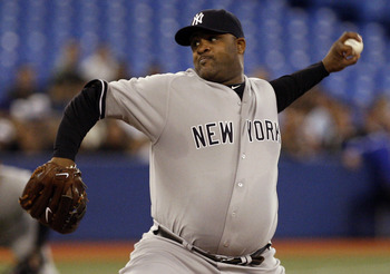 TORONTO, CANADA - SEPTEMBER 16:  CC Sabathia #52 of the New York Yankees throws a pitch during MLB action against the Toronto Blue Jays at the Rogers Centre September 16, 2011 in Toronto, Ontario, Canada. (Photo by Abelimages/Getty Images)