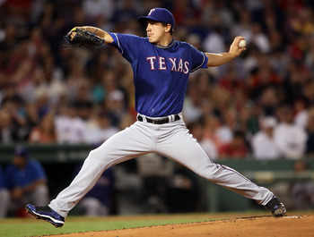 BOSTON, MA - SEPTEMBER 02:  Derek Holland #45 of the Texas Rangers delivers a pitch in the first inning against the Boston Red Sox on September 2, 2011 at Fenway Park in Boston, Massachusetts.  (Photo by Elsa/Getty Images)