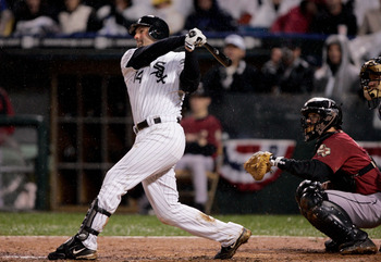CHICAGO - OCTOBER 23:  Paul Konerko #14 of the Chicago White Sox hits a grandslam home run against the Houston Astros in the seventh inning during Game Two of the 2005 Major League Baseball World Series at U.S. Celluar Field on October 23, 2005 in Chicago