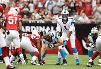 GLENDALE, AZ - SEPTEMBER 11:  Quarterback Cam Newton #1 of the Carolina Panthers in action during the NFL season opening game against the Arizona Cardinals at the University of Phoenix Stadium on September 11, 2011 in Glendale, Arizona. The Carindals defe