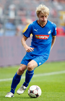 MANNHEIM, GERMANY - AUGUST 23: Andreas Beck of TSG 1899 Hoffenheim runs with the ball during the Bundesliga match TSG 1899 Hoffenheim against Borussia Moenchengladbach at the Carl Benz stadium in Mannheim on August 23, 2008 in Mannheim, Germany. (Photo by