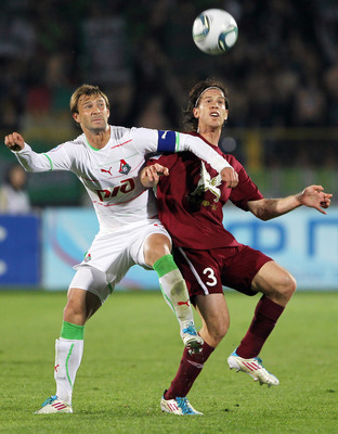 KAZAN, RUSSIA - MAY 20:  Cristian Ansaldi of FC Rubin Kazan battles for the ball with Dmitri Sychev of FC Lokomotiv Moscow during the Russian Football League Championship match between  FC Rubin vs FC Lokomotiv on May 20, 2011 in Kazan, Russia.  (Photo by