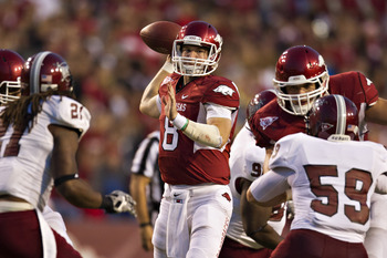 FAYETTEVILLE, AR - SEPTEMBER 17:  Tyler Wilson #8 of the Arkansas Razorbacks throws a pass against the Troy Trojans at Donald W. Reynolds Razorback Stadium on September 17, 2011 in Fayetteville, Arkansas.  (Photo by Wesley Hitt/Getty Images)