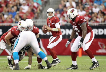 GLENDALE, AZ - SEPTEMBER 11:  Quarterback Kevin Kolb #7 of the Arizona Cardinals drops back to pass during the NFL season opening game against the Carolina Panthers at the University of Phoenix Stadium on September 11, 2011 in Glendale, Arizona. The Carin