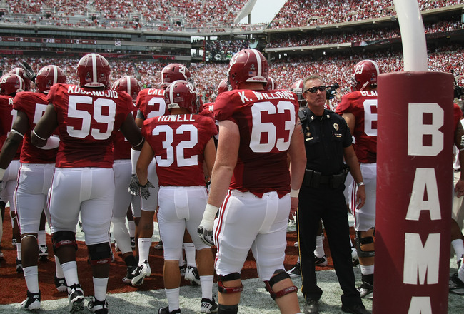 TUSCALOOSA, AL - SEPTEMBER 3:  Players of the Alabama Crimson Tide enters the field before the game with the Kent State Golden Flashes on September 3, 2011 at Bryant Denny Stadium in Tuscaloosa, Alabama.  Alabama defeated Kent State 48-7.  (Photo by Greg