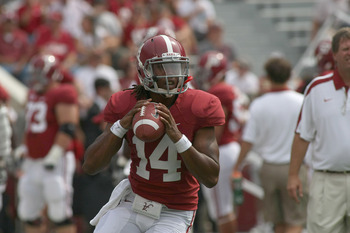 TUSCALOOSA, AL - SEPTEMBER 3:  Quarterback Phillip Sims #14 of the Alabama Crimson Tide warms up during pre-game drills before the game with the Kent State Golden Flashes on September 3, 2011 at Bryant Denny Stadium in Tuscaloosa, Alabama.  Alabama defeat