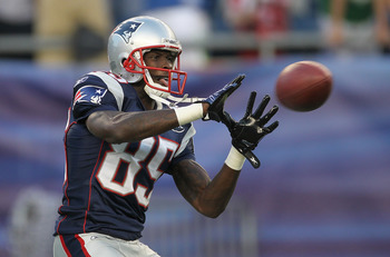 FOXBORO, MA - SEPTEMBER 1:   Chad Ochocinco #85 of the New England Patriots completes a drill before a game with the New York Giants at Gillette Stadium on September 1, 2011 in Foxboro, Massachusetts. (Photo by Jim Rogash/Getty Images)