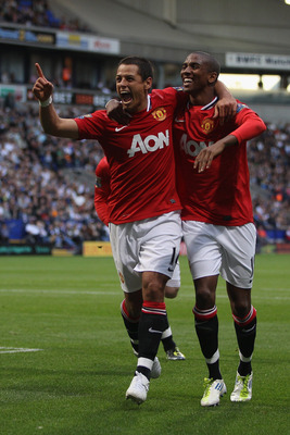 BOLTON, ENGLAND - SEPTEMBER 10:  Javier Hernandez (L) of Manchester United celebrates scoring the fourth goal with Ashley Young (R)  during the Barclays Premier League at the Reebok Stadium on September 10, 2011 in Bolton, England.  (Photo by Michael Stee