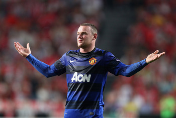 LISBON, PORTUGAL - SEPTEMBER 14:  Wayne Rooney of Manchester United gestures during the UEFA Champions League Group C match between SL Benfica and Manchester United at the Estadio da Luz on September 14, 2011 in Lisbon, Portugal.  (Photo by Clive Mason/Ge
