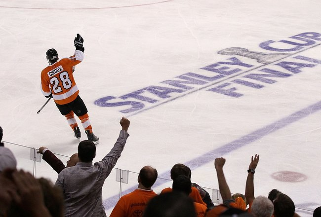 PHILADELPHIA - JUNE 02:  Claude Giroux #28 of the Philadelphia Flyers celebrates after scoring the game-winning goal in overtime to defeat the Chicago Blackhawks 4-3 in Game Three of the 2010 NHL Stanley Cup Final at Wachovia Center on June 2, 2010 in Phi