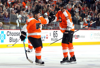 PHILADELPHIA - JANUARY 23:  Kimmo Timonen #44 and Chris Pronger #20 of the Philadelphia Flyers celebrates their teams fourth goal against the Carolina Hurricanes on January 23, 2010 at Wachovia Center in Philadelphia, Pennsylvania. The Flyers defeated the