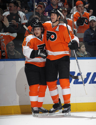 UNIONDALE, NY - DECEMBER 05: Danny Briere #48 (L) of the Philadelphia Flyers celebrates his game winning goal at 14:16 of the third period against the New York Islanders and is joined by Chris Pronger #20 at the Nassau Coliseum on December 5, 2010 in Unio