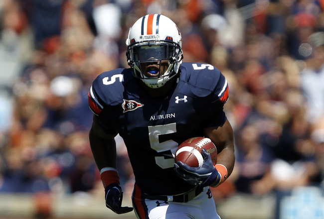 AUBURN, AL - SEPTEMBER 10:  Running back Michael Dyer #5 of the Auburn Tigers runs for a first down against the Mississippi State Bulldogs in the first half on September 10, 2011 at Jordan-Hare Stadium in Auburn, Alabama. (Photo by Butch Dill/Getty Images