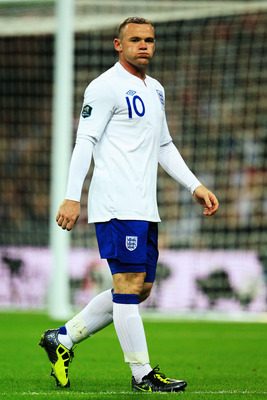 LONDON, ENGLAND - SEPTEMBER 06:  Wayne Rooney of England reacts during the UEFA EURO 2012 group G qualifying match between England and Wales at Wembley Stadium  on September 6, 2011 in London, England.  (Photo by David Cannon/Getty Images)