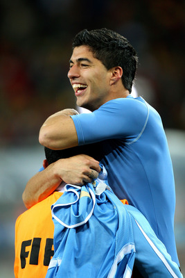 JOHANNESBURG, SOUTH AFRICA - JULY 02:  Luis Suarez celebrates victory after a penalty shoot out during the 2010 FIFA World Cup South Africa Quarter Final match between Uruguay and Ghana at the Soccer City stadium on July 2, 2010 in Johannesburg, South Afr