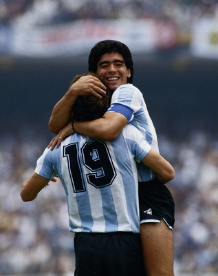 Diego Maradona of Argentina congratulates team mate Oscar Ruggeri #19 after he scores the second goal against the Republic of Korea during the Group A match at the 1986 FIFA World Cup on 2nd June 1986 at the Olimpico Stadium in Mexico City, Mexico. Argent