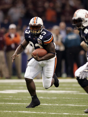 NEW ORLEANS - JANUARY 03:  Running back Ronnie Brown #23 of the Auburn Tigers runs with the ball against the Virginia Tech Hokies during the Nokia Sugar Bowl on January 3, 2005 at the Superdome in New Orleans, Louisiana.  (Photo by Chris Graythen/Getty Im