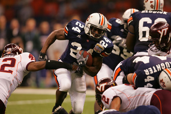NEW ORLEANS - JANUARY 03:  Running back Carnell Williams #24 of the Auburn Tigers runs with the ball against the Virginia Tech Hokies during the Nokia Sugar Bowl on January 3, 2005 at the Superdome in New Orleans, Louisiana.  (Photo by Matthew Stockman/Ge