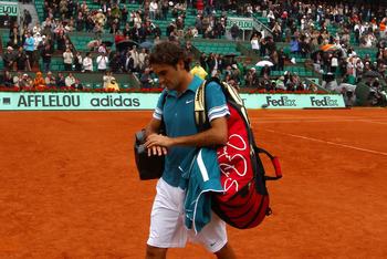 PARIS - JUNE 01: Roger Federer of Switzerland walks off after losing the men's singles quarter final match between Robin Soderling of Sweden and Roger Federer of Switzerland at the French Open on day ten of the French Open at Roland Garros on June 1, 2010