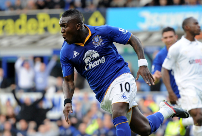 LIVERPOOL, ENGLAND - SEPTEMBER 17:  Royston Drenthe of Everton celebrates scoring his team's third goal during the Barclays Premier League match between Everton and Wigan Athletic at Goodison Park on September 17, 2011 in Liverpool, England.  (Photo by Ch
