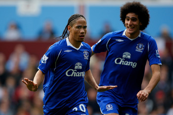 BIRMINGHAM, ENGLAND - APRIL 12:  Everton player Steven Pienaar (L) celebrates with Marouane Fellaini after scoring the third Everton goal during the Premier League  match between Aston Villa and Everton at Villa Park on April 12, 2009 in Birmingham, Engla