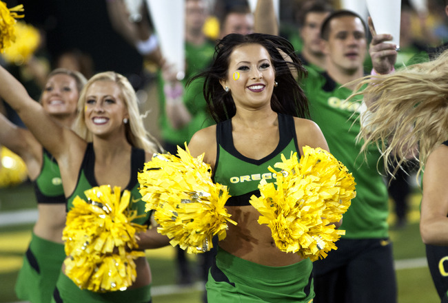 EUGENE, OR - OCTOBER 6: Oregon Cheerleaders run out onto the field before the game against the Washington Huskies on October 6, 2012 at Autzen Stadium in Eugene, Oregon. Oregon won the game 52-21. (Photo by Steve Dykes/Getty Images)