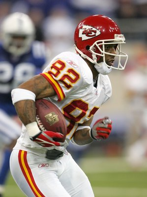 INDIANAPOLIS - JANUARY 06:  Dante Hall #82 of the Kansas City Chiefs runs with the ball against the Indianapolis Colts during their AFC Wild Card Playoff Game January 6, 2007 at RCA Dome in Indianapolis, Indiana. The Colts won 23-8.  (Photo by Andy Lyons/